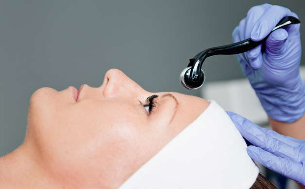 woman having microneedling session